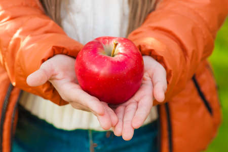 Red apple in the children\ photo