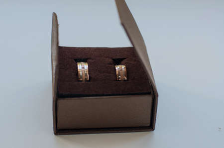 gold wedding rings near gift boxes photo
