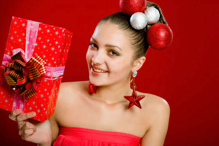 Beautiful girl with a gift box and christmas decorations photo
