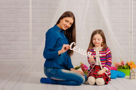 20 24 years old: Elder sister and little girl smiling