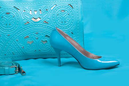 no heels: Beautiful blue shoes and handbag on blue background