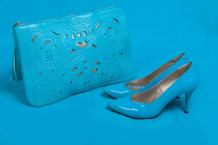 no heels: Beautiful blue shoes and handbag on blue background