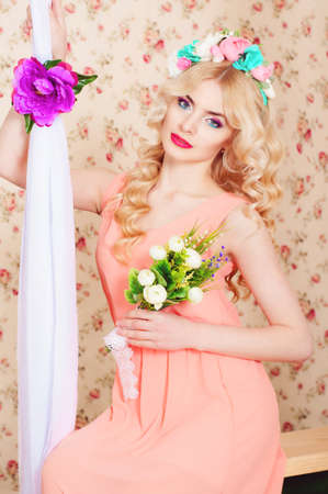 fair hair: Girl with long fair hair in a flower wreath