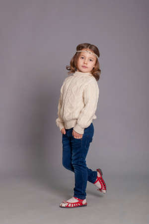 3 persons only: Little girl in white sweater and blue jeans