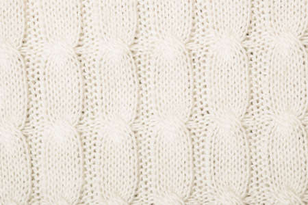 White knitted texture with ornament braid Stock Photo