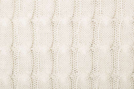 plaiting: White knitted texture with ornament braid Stock Photo