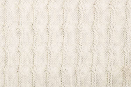 knotted rope: White knitted texture with ornament braid Stock Photo