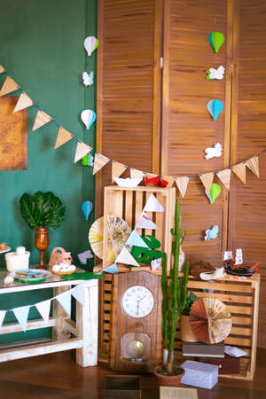 Vintage Decals on the theme of a small traveler with themed kandibar with airplanes, garlands, paper boats and a vintage world map. Delicious sweet buffet with cupcakes, meringues and other desserts