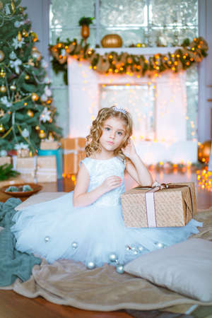 Little girl with curly hair with present box Stock Photo