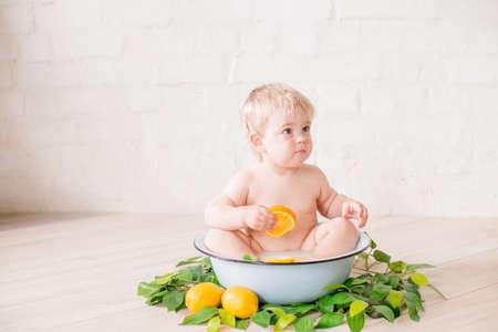 baby boy in an antique milk bath