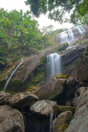 High waterfall in tropical area of Thailand photo