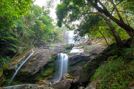 Waterfall in the tropical rain forest of Thailand  photo