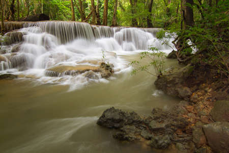 The small waterfall in the deep forest in the tropical area  photo