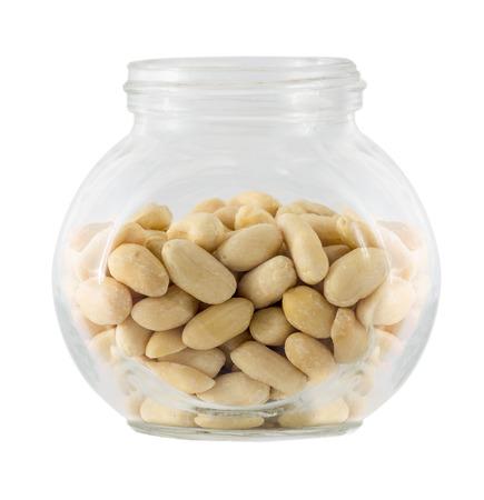 tare: Raw peanuts in small glass tare Stock Photo