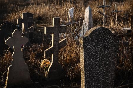 christian halloween: Tombstones in sunset in