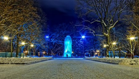 Winter cityscape with frozen fountain
