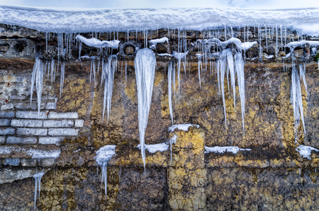 Spectacular icicles ont he wall front view Banco de Imagens