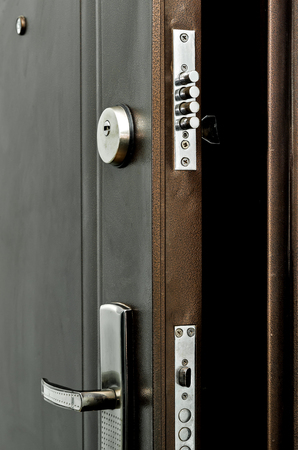 Abstract opened brown door lock seen