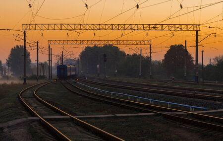 Living passenger train on sunrise