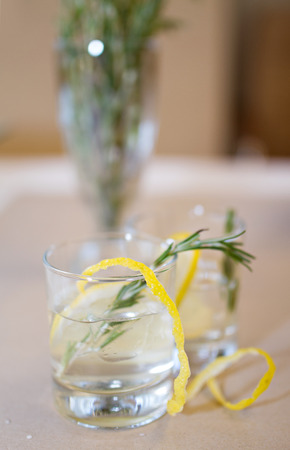 cocktails: Photo of Two cocktail glasses and rosemary branches on a table Stock Photo