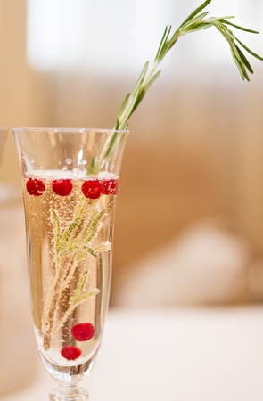 champaigne: Photo of a glass of Champagne and rosemary branch