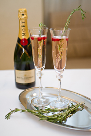 champaigne: Photo of Two glasses of Champagne and rosemary on a plate with a bottle of Champaign Stock Photo