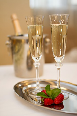 champaign: Photo of Two glasses of Champagne and strawberries on  plate with a bottle of Champaign