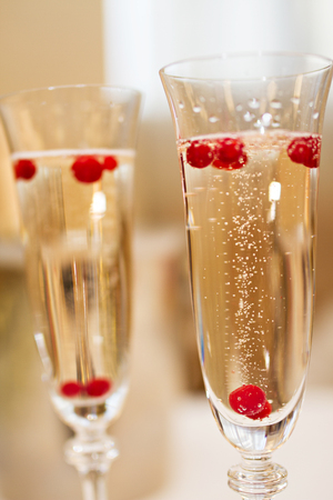 champaigne: Photo of Two glasses of Champagne with berries Stock Photo