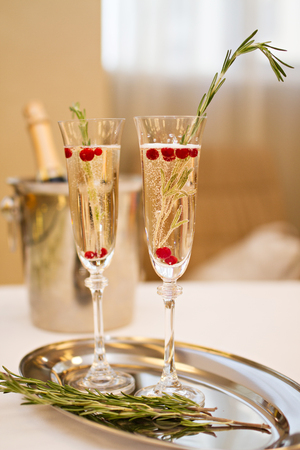 champaign: Photo of Two glasses of Champagne and rosemary on a plate with a bottle of Champaign Stock Photo