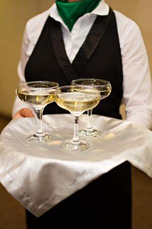 champaigne: Photo of Three glasses of Champagne a waiter