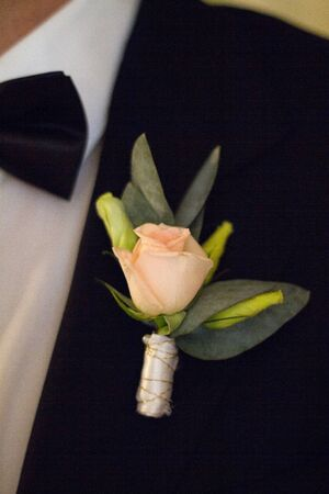 man's suit: Wedding blossom of a rose on mans suit