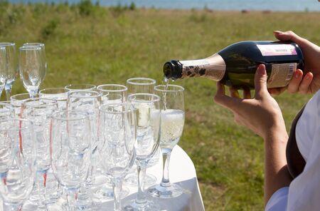 champaigne: Glasses of champaigne and a bottle of champaign in a wedding day