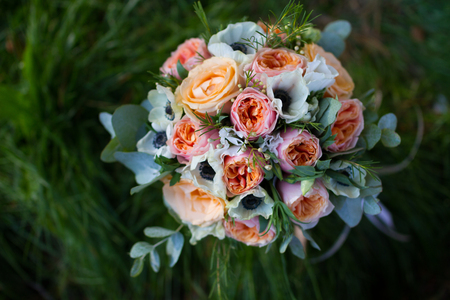 bride: Wedding bunch of flowers in red, orange, and white Stock Photo
