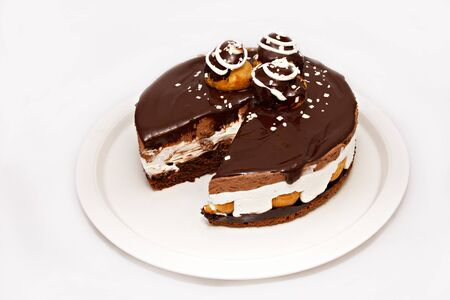 strew: Chocolate cake with nuts and white strew on white plate
