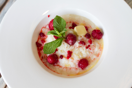 baby rice: Sweet boiled rice with raspberry and mint Stock Photo