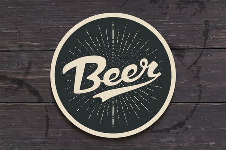 Coaster for beer with hand drawn lettering Beer. Monochrome vintage drawing for bar, pub and beer themes. Black circle for placing a beer mug or a bottle over it with lettering. Vector Illustration Stock Illustratie
