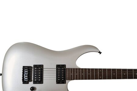 Electric musical instrument. Closeup of white electric six string guitar black pickups and control knobs isolated on white background. Isolated on white background