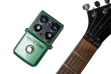 Musical equipment. Electric guitar neck and guitar effect pedal isolated on white with clipping path