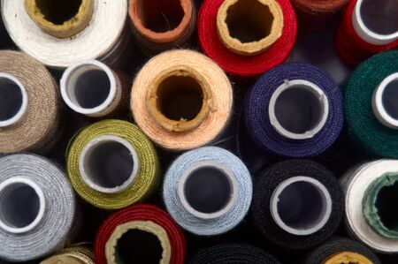 A set of threads of different colors. Many threads for sewing and needlework are different in color. Multicolored palette of threads 写真素材