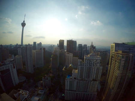 kl: Sunrise with high building in KL , Malaysia