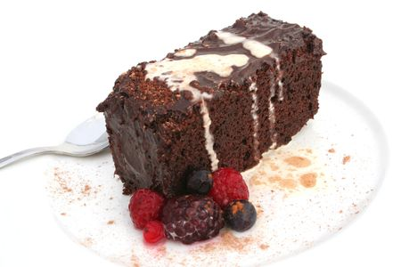 Isolated chocolate cake and berries