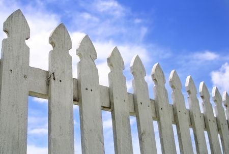 neighbour: White Picket Fence and Blue Sky