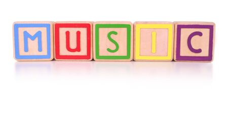Isolated colorful childrens blocks spelling the work music against a white background