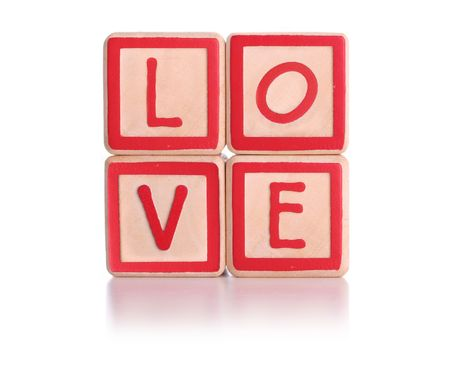 Isolated childrens blocks spelling love with clipping path
