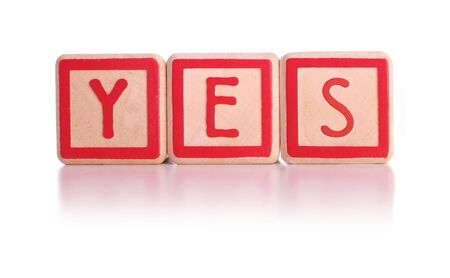 allow: Isolated childrens blocks spelling the word yes - with clipping path
