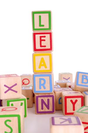 prep: Childrens colored blocks spelling the work learning and surrounded by other blocks - has clipping path