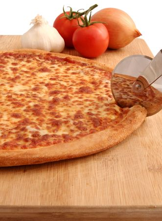 A pepperoni pizza being cut on board - isolated with clipping path
