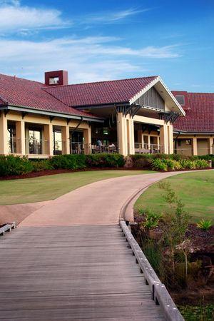 Golf clubhouse - 19th hole against a blue sky