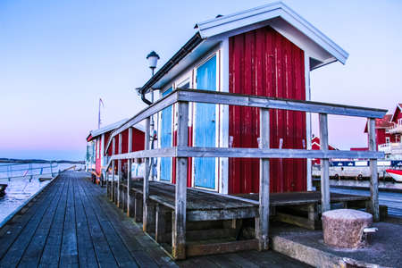 Red cabin on a pontoon in sweden