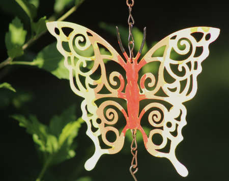 Butterfly chime hanging in a garden